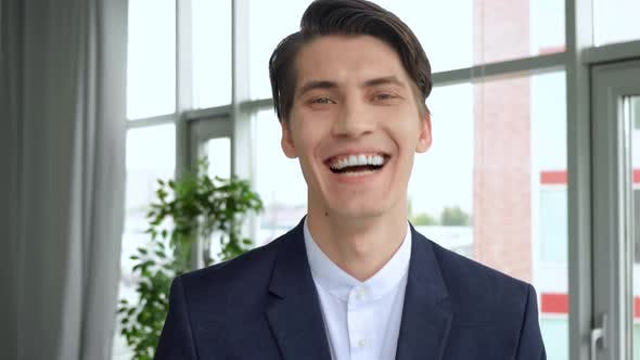 Thumbnail for Cheerful guy smiling and looking to camera. 4k Handsome european man with trendy hairdo studio