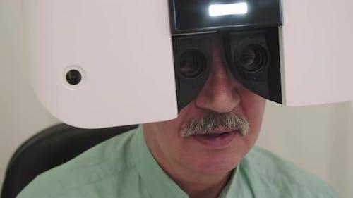 Senior Man Doing Eye Vision Test