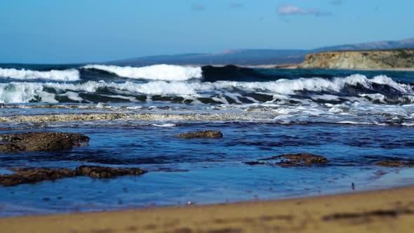 Thumbnail for Dark Blue Sea Waves Splashing on Sandy Beach on Sunny Summer Day. Foamy Waters of Mediterranean Sea