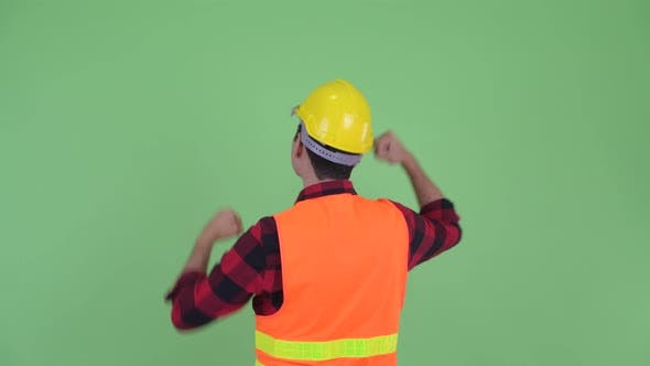 Thumbnail for Rear View of Happy Young Multi Ethnic Man Construction Worker with Fists Raised
