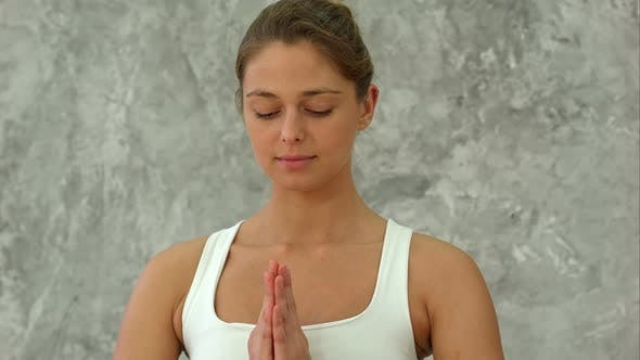 Cover Image for Beautiful Young Woman in Sportswear Practicing Yoga and Looking at Camera While Sitting in Lotus