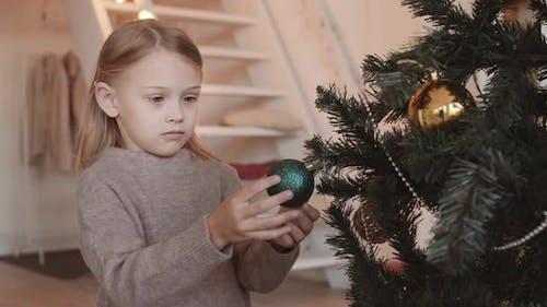 Little Girl Holding Bauble