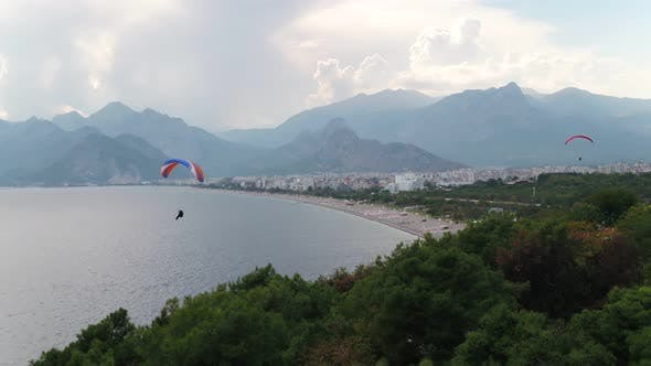 Thumbnail for Paragliding Over Sea With View Of Mountains And Green