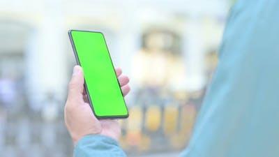 Outdoor Man Watching Smartphone with Green Screen