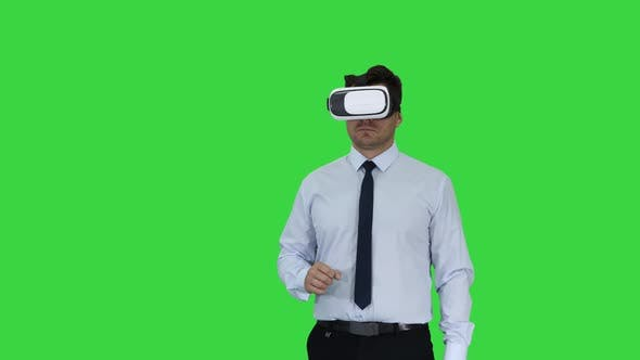 Thumbnail for Businessman in VR Glasses and Interacting with Virtual Reality Objects on a Green Screen, Chroma Key