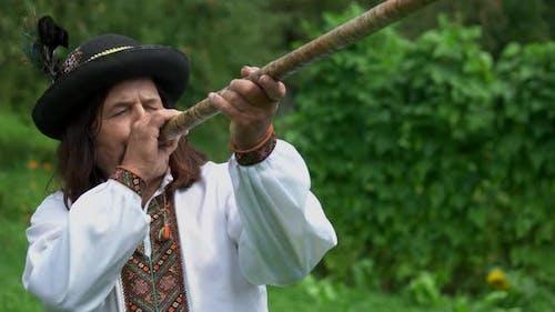 Carpathian Man with Folk Music Instrument
