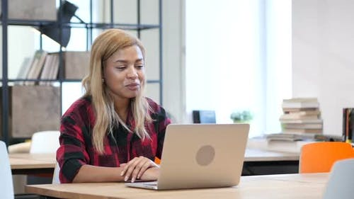 Online Video Chat by Black Girl on Laptop