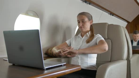 Thumbnail for Businesswoman Using Laptop Computer on Business Private Jet Board