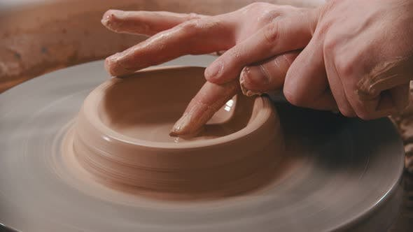 Thumbnail for Pottery - the Master Is Unfolding Clay with His Finger on the Potter's Wheel