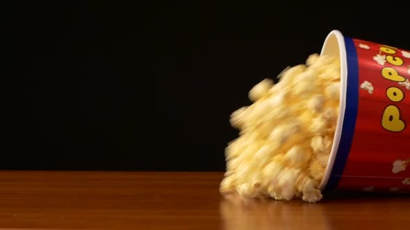 Thumbnail for Popcorn in Box Falling and Drop, on Black, Slow Motion