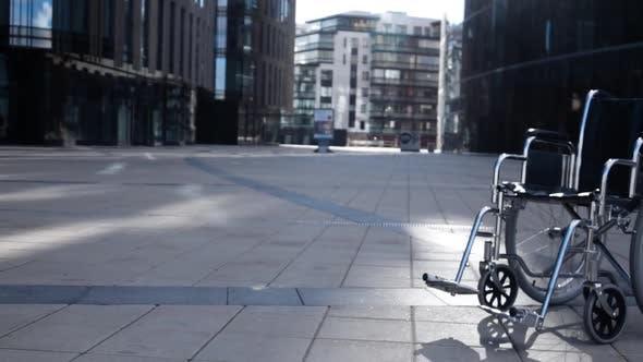 Thumbnail for Cripple Wheelchair Rolling Near Modern Building.