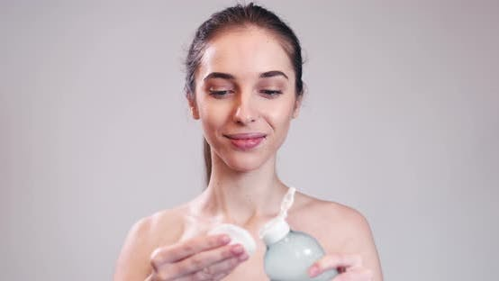 Thumbnail for Girl Cleaning Face with Wet Cotton Pad