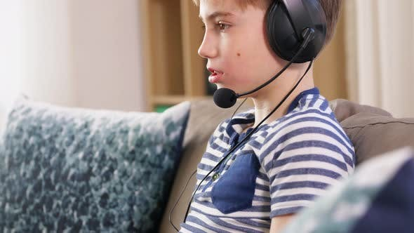 Thumbnail for Boy with Gamepad Playing Video Game at Home