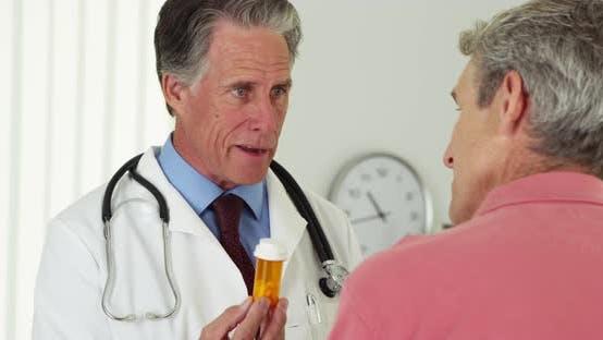 Doctor talking to elderly patient about prescription