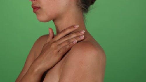Young Woman Touching Her Shoulder Sensually