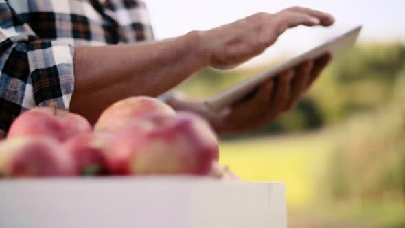 Thumbnail for Close up of tablet used in the orchard