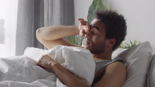 Black Man Waking Up in the Morning