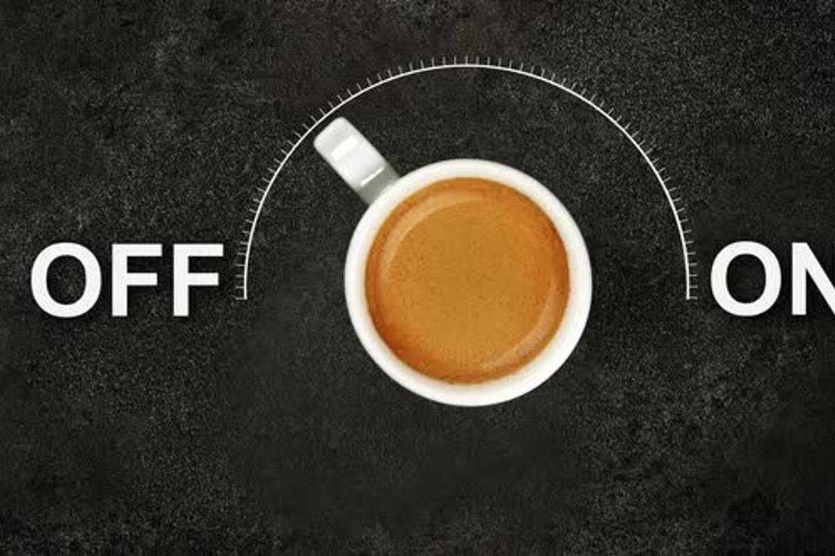 Cup of espresso coffee and on off power switch by BreakingTheWalls on  Envato Elements