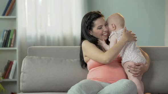 Thumbnail for Cute Toddler Girl Kissing and Hugging Her Mother, Love and Tenderness in Family