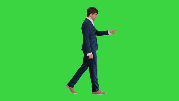 Thumbnail for Businessman Walking and Explaining Something To Camera on a Green Screen, Chroma Key.