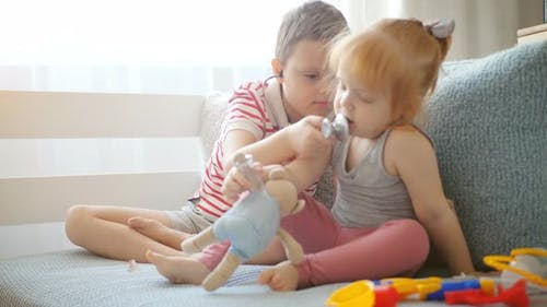 Cute Little Kids Playing at Hospital at Home