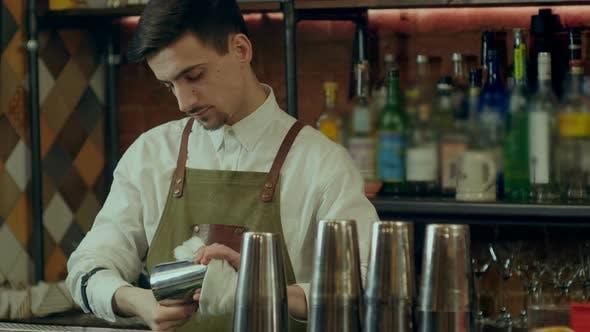 Thumbnail for Barman Rub Metal Shakes with Napkin at Work Place
