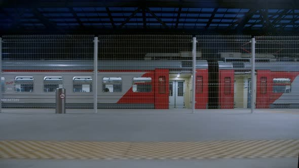 Thumbnail for Train Leaves Empty Station Platform at Airport