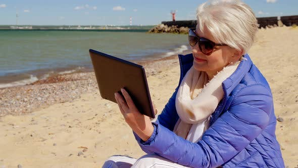Thumbnail for Senior Woman with Tablet Computer on Beach