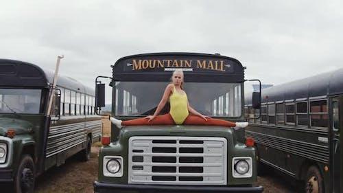 Agile Dancer Doing Splits On Bus