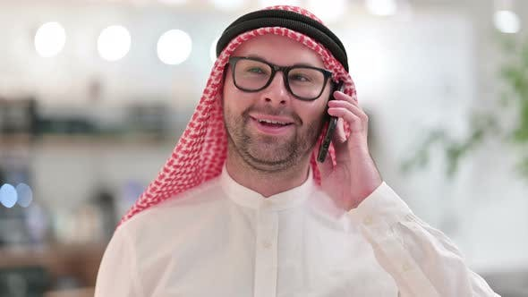 Thumbnail for Young Arab Businessman Talking on Smartphone