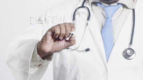 Asian Doctor Writes Dental Hygiene