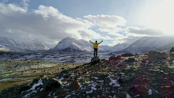 Thumbnail for Successful Young Man Standing On Top Of Mountain Edge Snow Winter Extreme Conditions Success Achieve