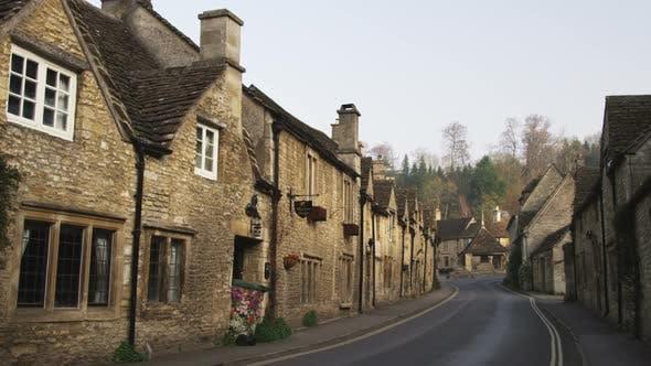 Street in-between old stone buildings in England.