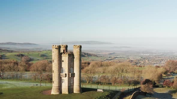 Aerial drone video of Broadway Tower, a famous old building landmark in The Cotswolds Hills, iconic