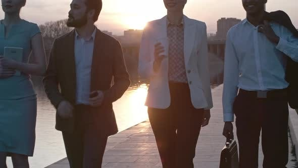 Thumbnail for Business Partners Walking at Sunset