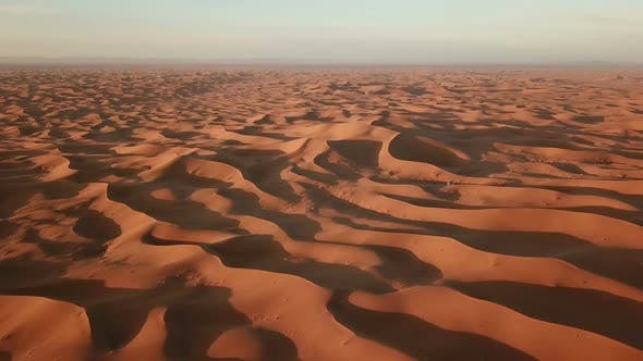 Thumbnail for Flying Over Sand Dunes in Sahara Desert at Sunrise