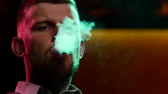 Man Smoking Shisha at Restaurant. Slow Motion. Silhouette