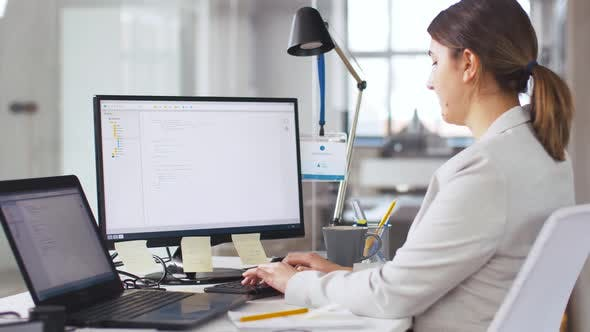 Thumbnail for Female Programmer with Computer Working at Office 1