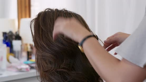 Thumbnail for Hairdresser creat hairstyle for bride in salon
