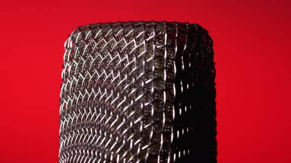 Thumbnail for Studio Condenser Microphone Rotates on Red Background.