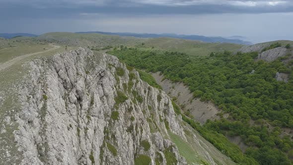 Thumbnail for Couple in Mountains on the Edge of an Impressive Cliff in Crimea