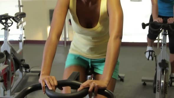 Thumbnail for Group working out on bicycles in a gym