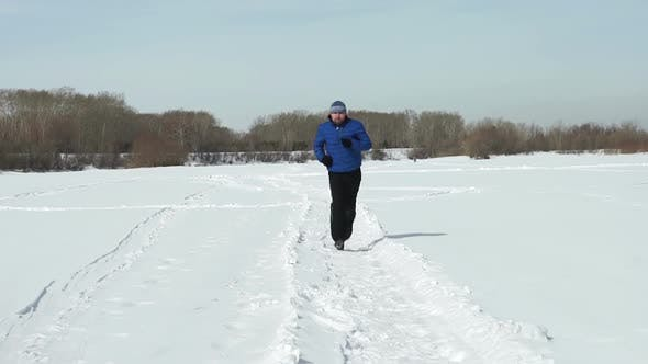Thumbnail for Young Man Is Running In Winter