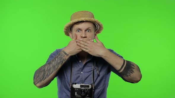 Portrait of Young Man Tourist Photographer Looking Shocked, Chroma Key