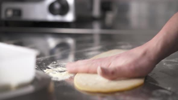 Thumbnail for Hands Sprinkle Flour on Dough. Fresh Noodles Preparation