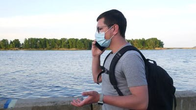 A Man Walks Along The River Bank