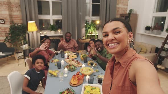 POV Of Big Afro Family Having Dinner Together