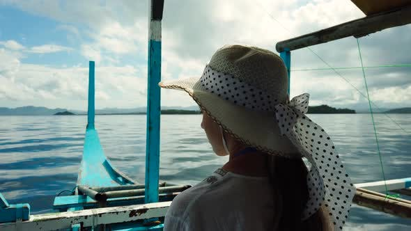 Thumbnail for Girl in a Hat on a Boat.