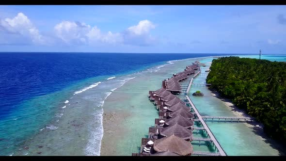 Aerial nature of beautiful seashore beach voyage by blue sea with white sandy background of a dayout