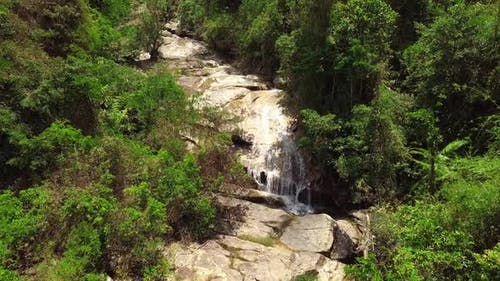 Drone Flight Over a Waterfall in the Tropical Rainforest Jungle on Summer Day